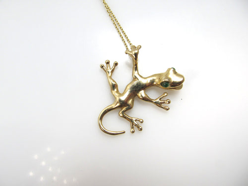 Super cute 14k gold gecko necklace with emerald eyes