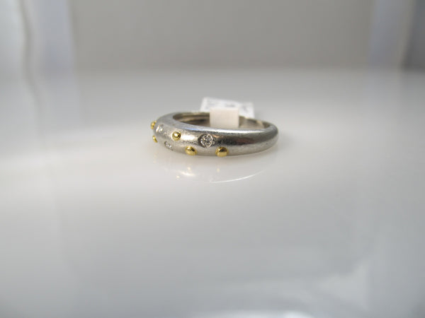Platinum and 18k yellow gold diamond band