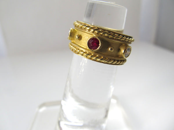 Estate 18k yellow gold wide ruby diamond band
