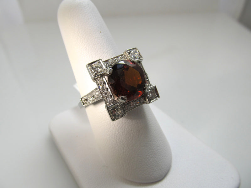 Huge antique platinum ring with a garnet and diamonds