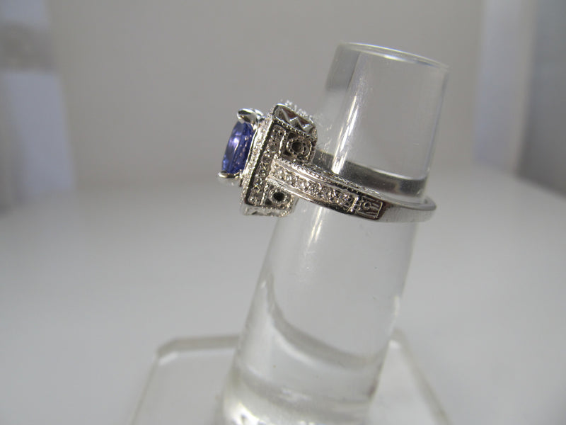 2.75ct tanzanite and diamond halo ring