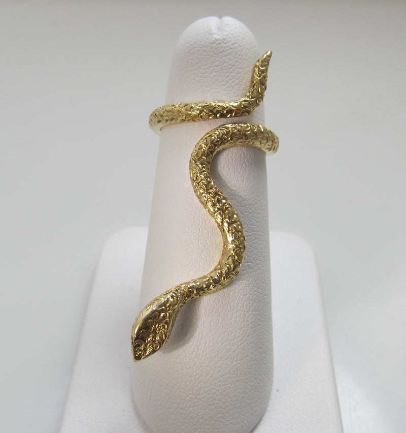 Neat vintage long snake ring with sapphire eyes