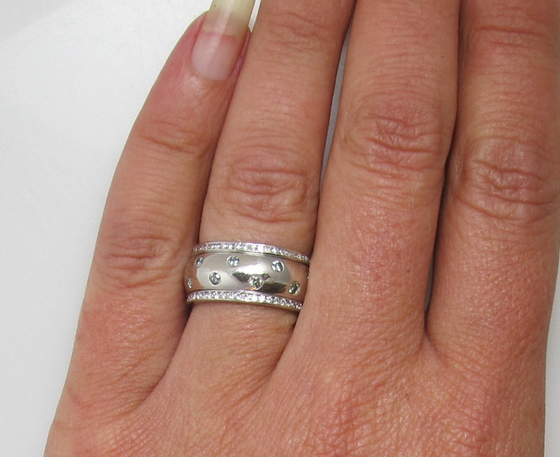 Platinum eternity band with light blue and white diamonds