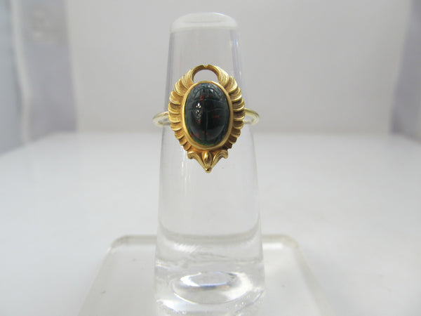 Egyptian revival conversion ring with a bloodstone scarab, circa 1920.