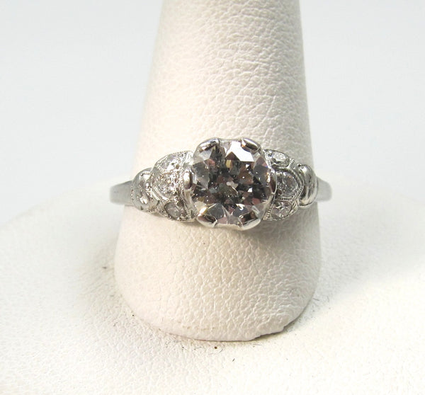 Antique platinum filigree ring with a .88ct diamond