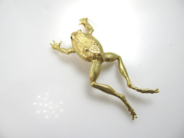 Signed AH 18k yellow gold leaping frog pendant, emerald eyes
