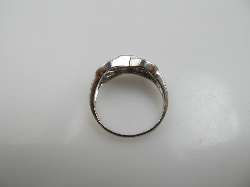 14k white gold ring with a .35ct center diamond, dated 1966
