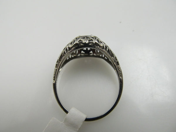 18k White Gold Filigree Ring With A .60ct Oec Diamond, Si1 F-g. Circa 1920.
