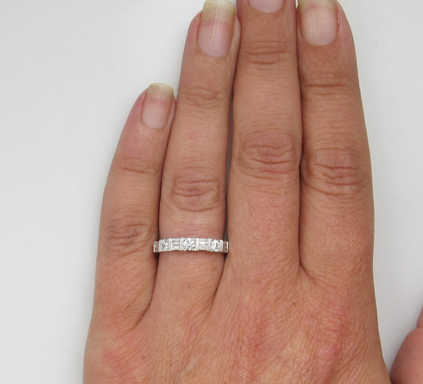 14k White Gold Band With .70cts In Round And Baguette Cut Diamonds