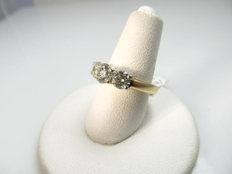 14k ring with 3 diamonds totaling 1.46cts