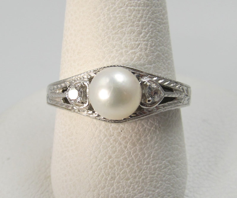 14k white gold ring with diamonds and a pearl