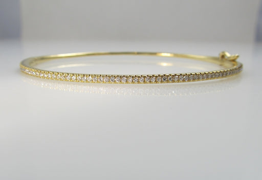 18k yellow gold bangle bracelet with .52cts in diamonds signed Bony Levy