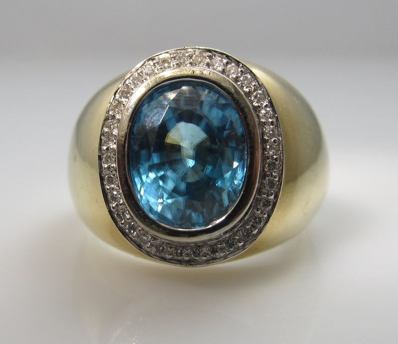 Modern Estate 14k Ring With A 5.00ct Blue Zircon And .20cts In Diamonds