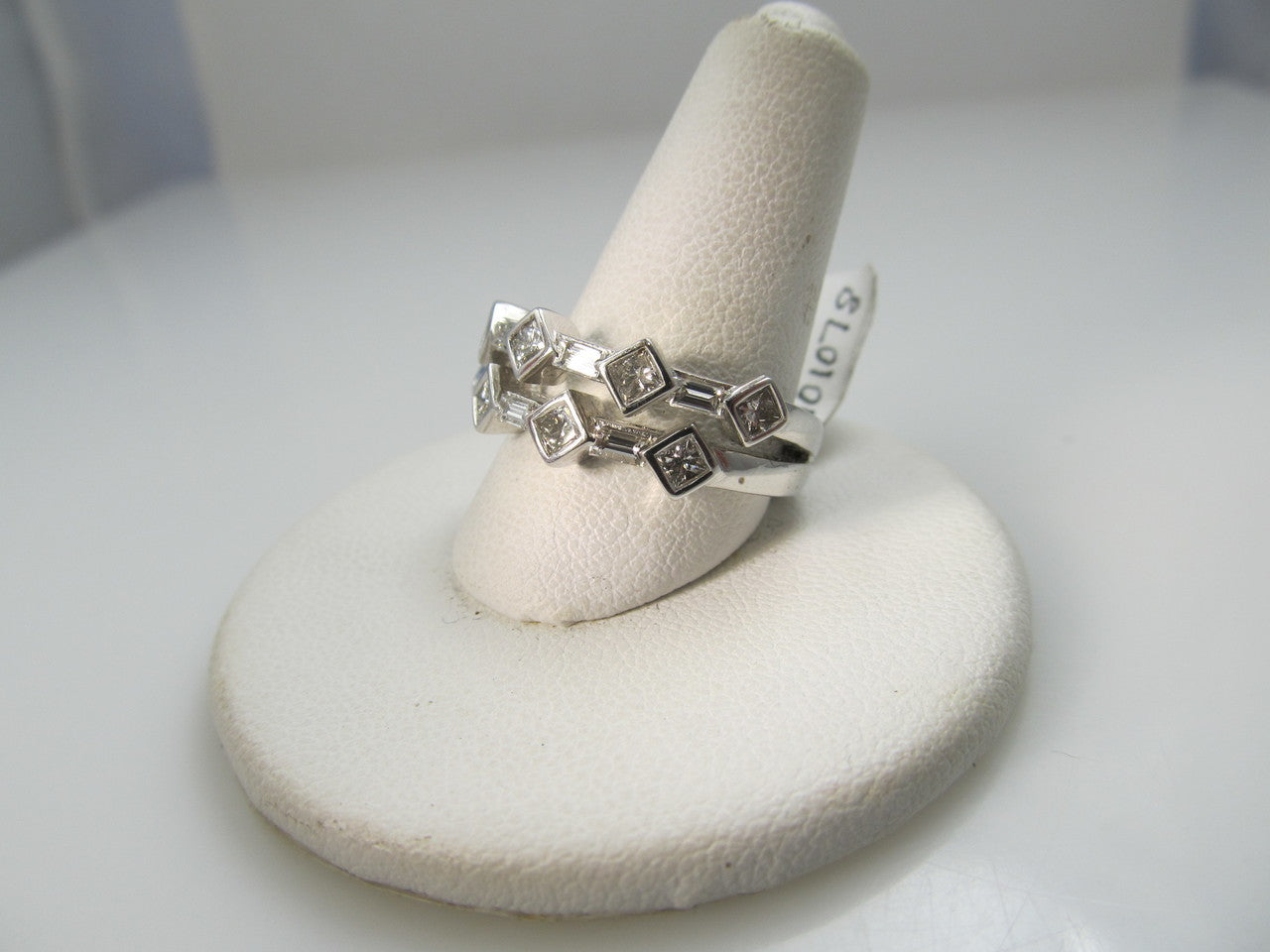 14k White Gold Ring With .85cts In Princess And Baguette Cut Diamonds.