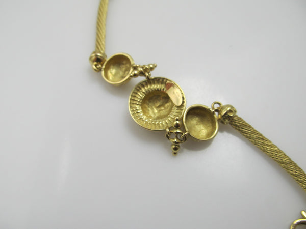 18k yellow gold bracelet with faces