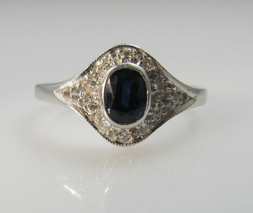 14k white gold ring with a .25ct sapphire and diamonds