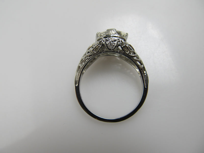 18k White Gold Filigree Ring With A 1.21ct Oval Cut Diamond, Circa 1920