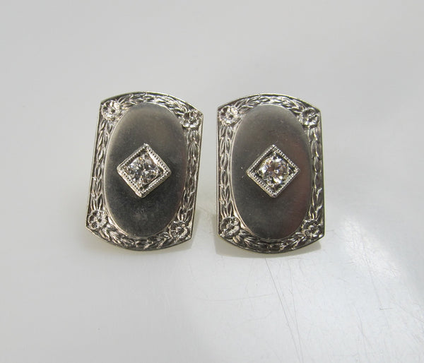 14k and platinum earrings with .20cts in diamonds, circa 1920.