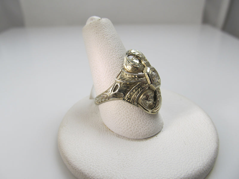 18k white gold filigree ring with a .20ct diamond, circa 1920