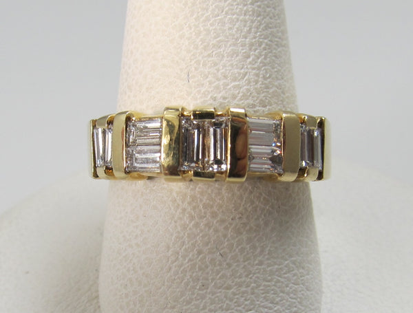 14k yellow gold ring with .70cts in baguette cut diamonds