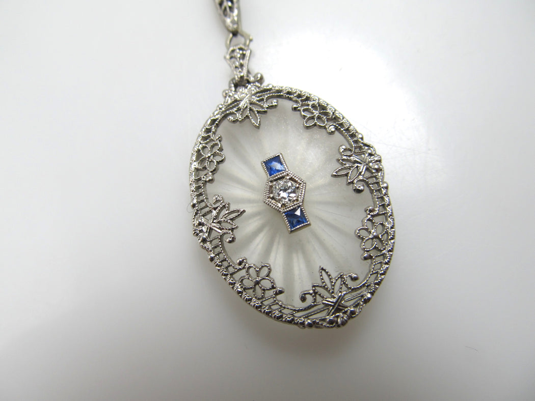 14k White Gold Filigree Necklace With A Diamond, Sapphires And Camphor Glass, Circa 1920