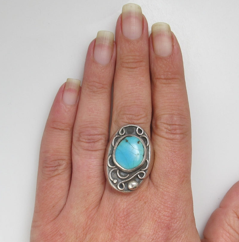 Heavy vintage sterling silver turquoise ring