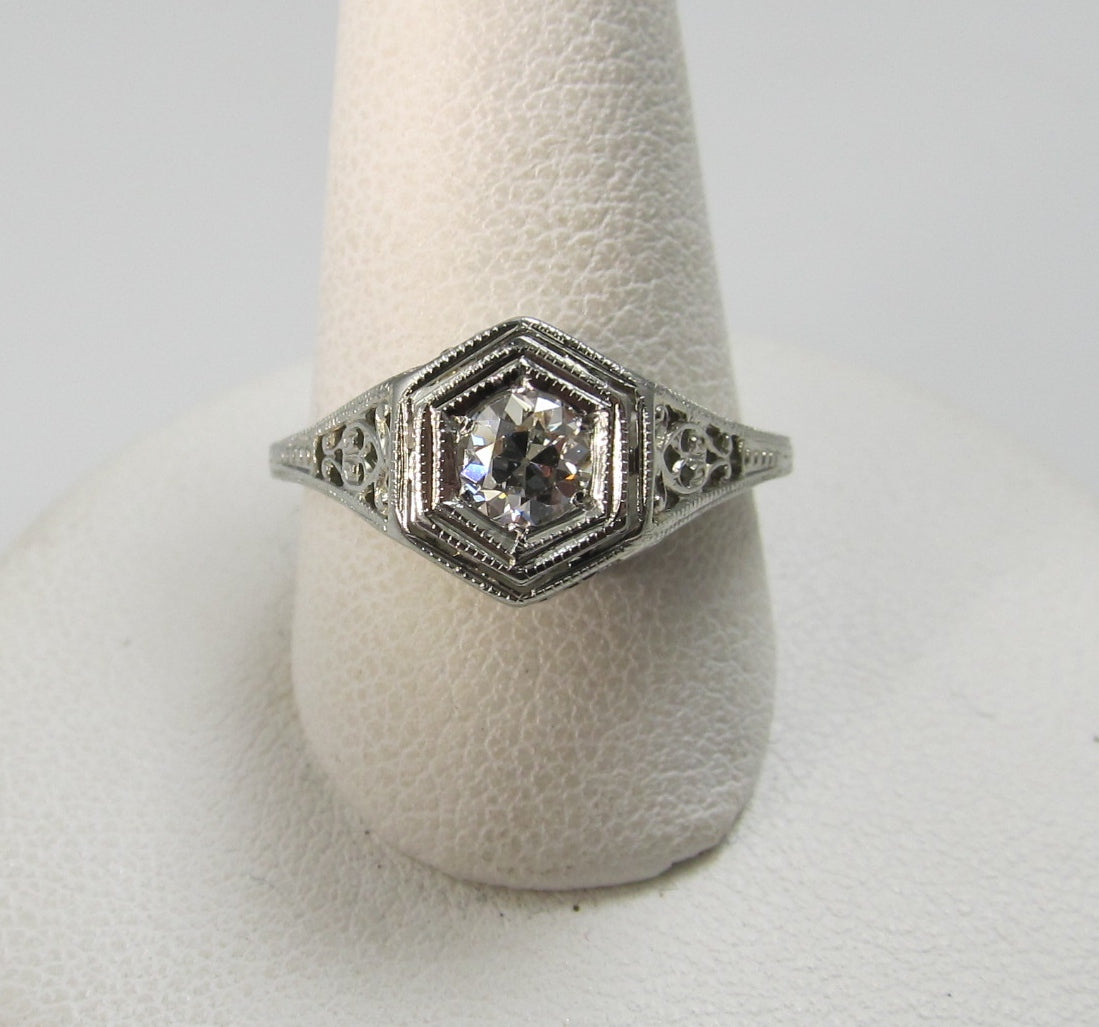 18k white gold filigree ring with a .33ct center diamond, circa 1920