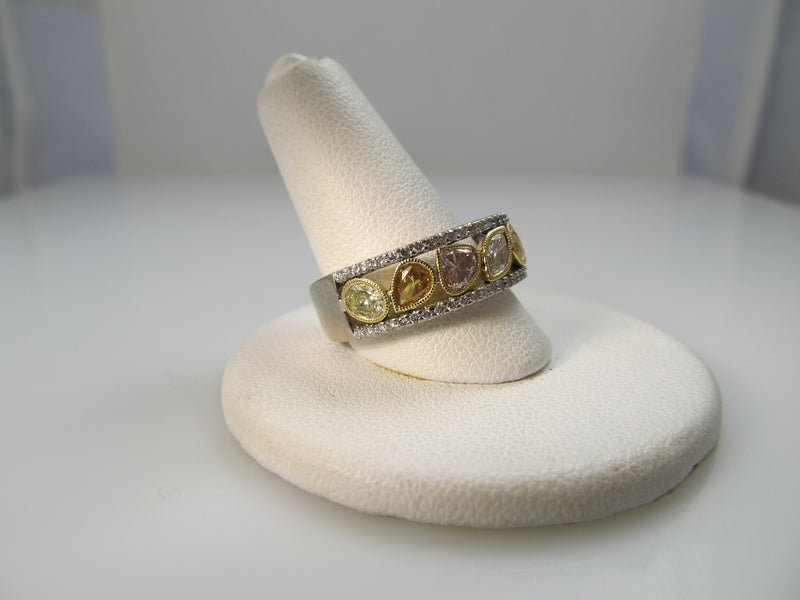 18k white gold band, 1.50ct in fancy yellow diamonds