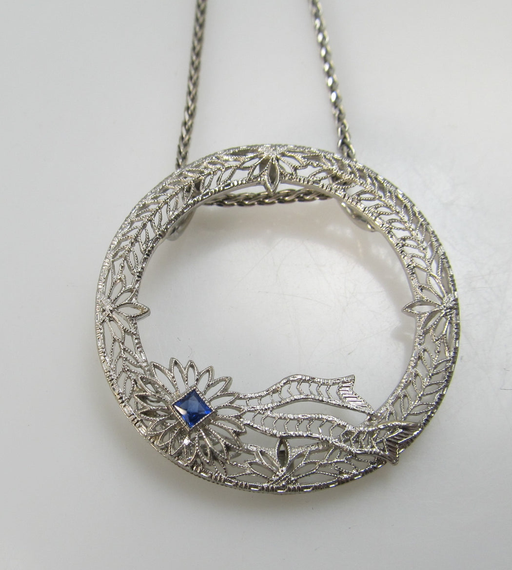 14k white gold filigree circle necklace with a sapphire, circa 1920