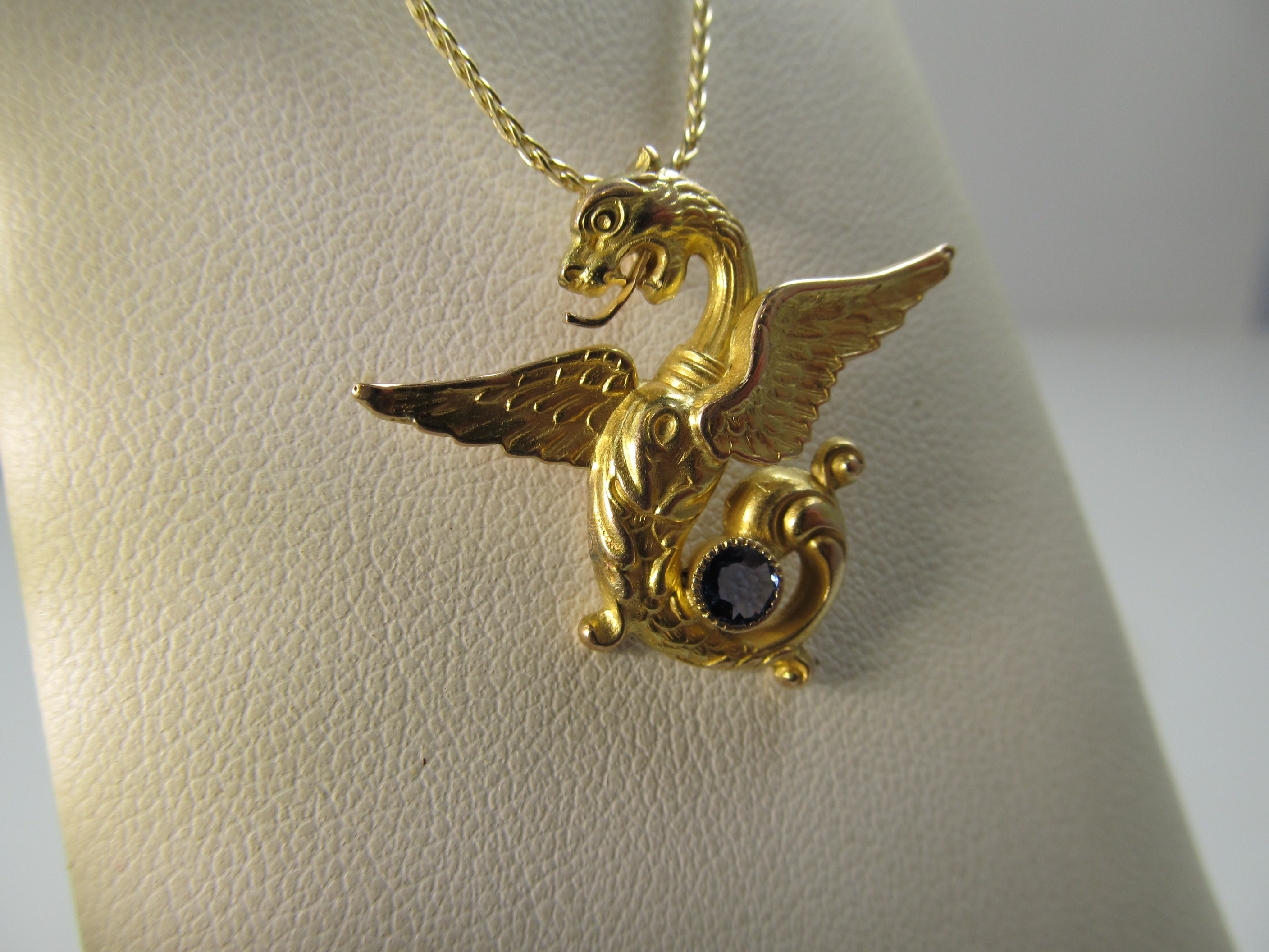 Antique 14k yellow gold griffin necklace with a sapphire, circa 1900