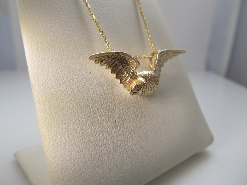 14k rose gold eagle necklace with a diamond eye, circa 1900.