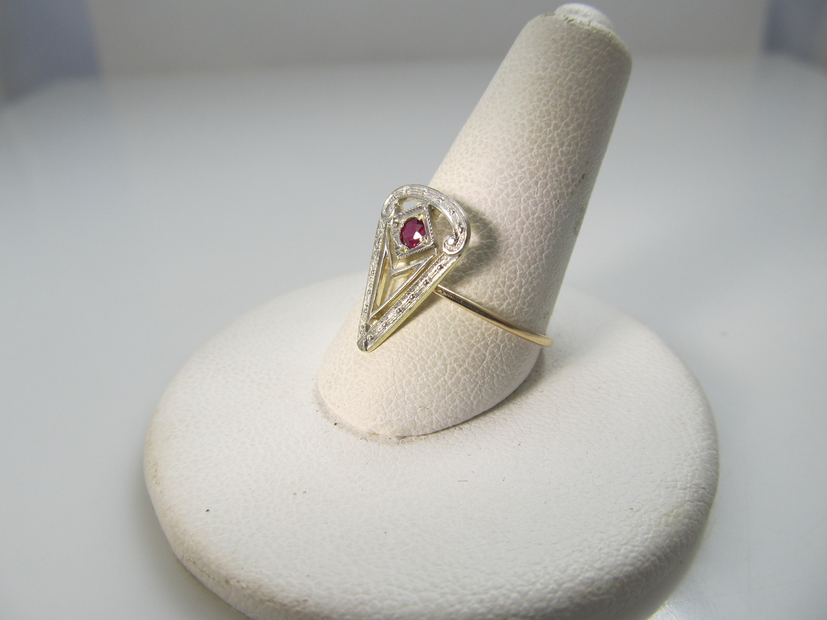14k white and yellow gold filigree ring with a ruby, circa 1920