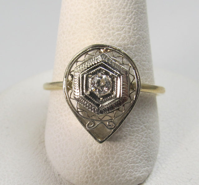 14k white and yellow gold filigree ring with a .10ct diamond, circa 1920.