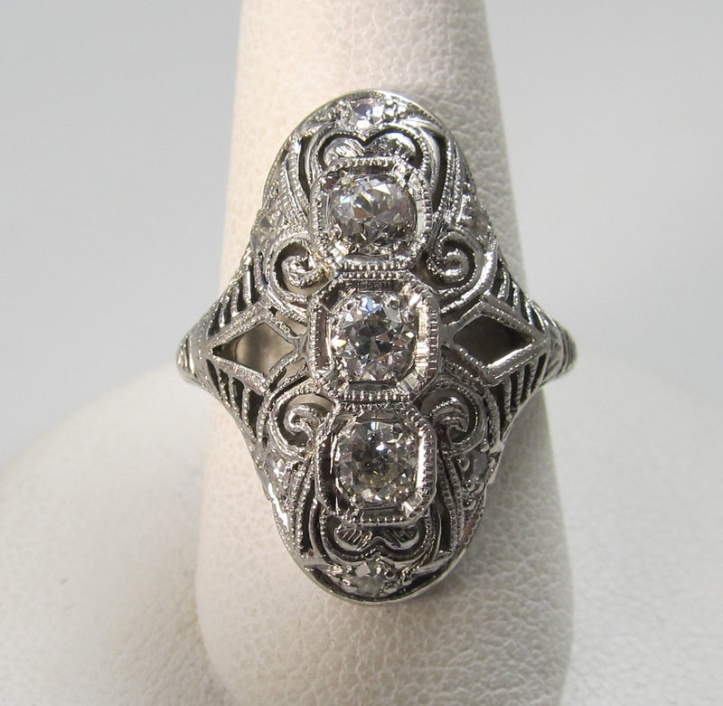 Platinum & 18k long filigree ring with .50cts in diamonds, circa 1920