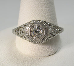 Antique platinum 18K filigree diamond engagement ring