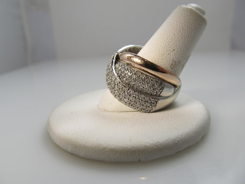 14k rose and white gold band with pave set diamonds