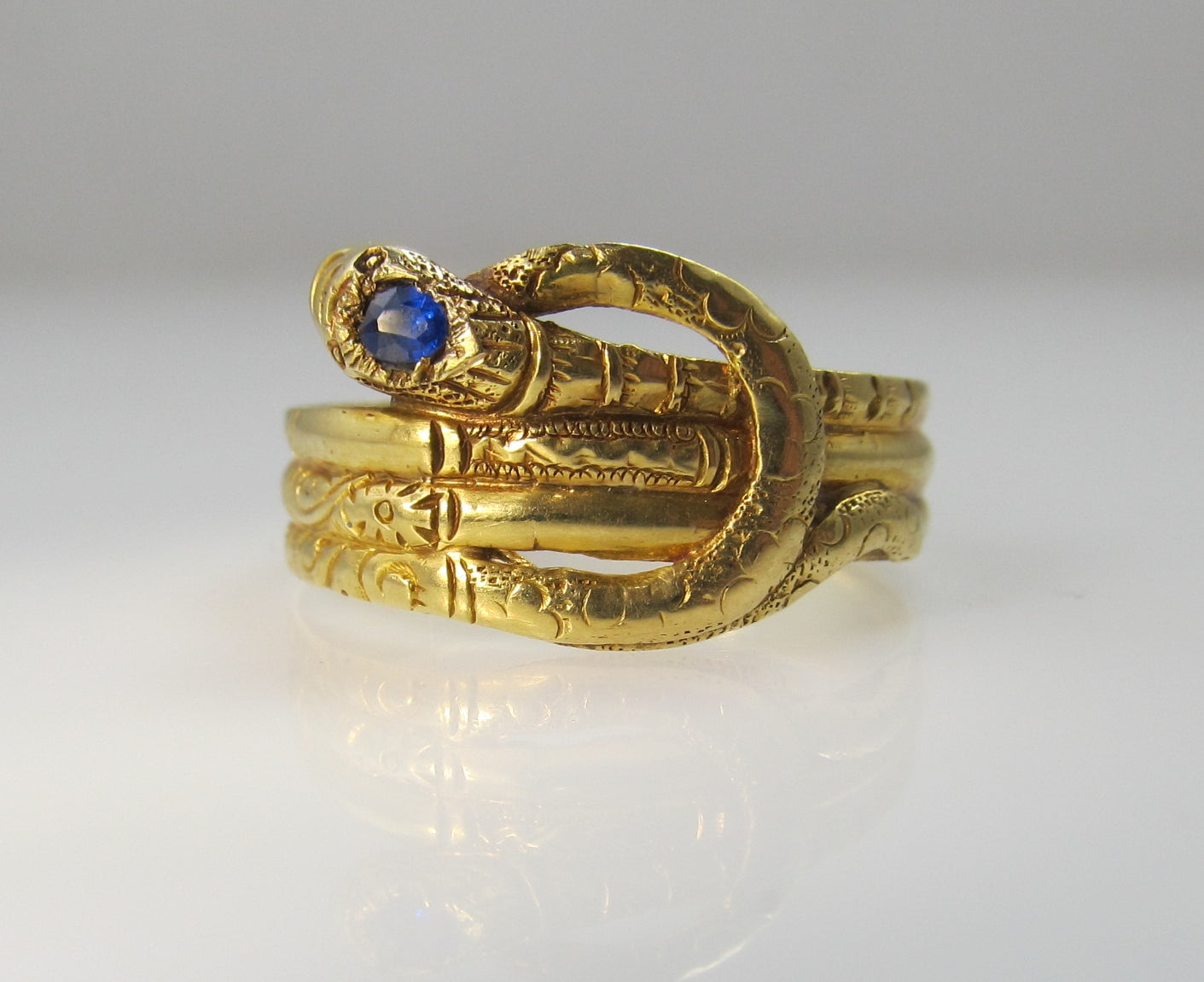 Early Victorian 14k wrapped snake ring with a sapphire