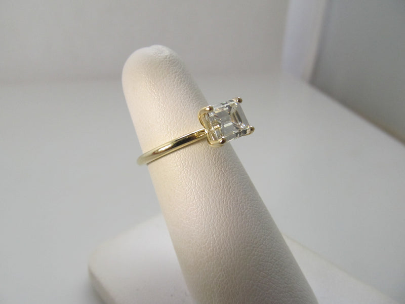 2.13ct emerald cut diamond east west ring