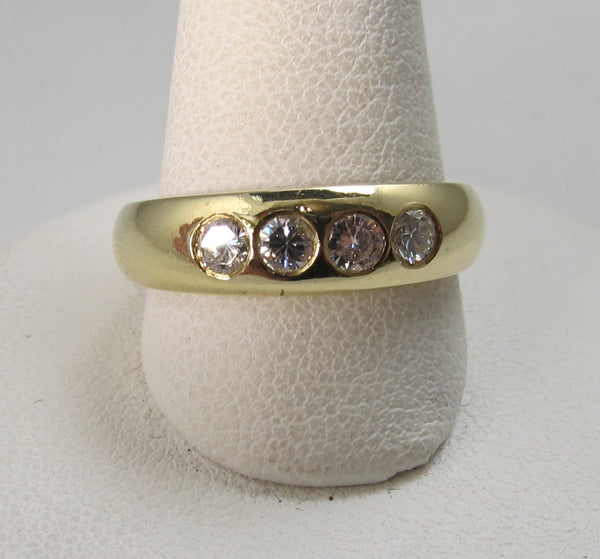 18k yellow gold flush set diamond band