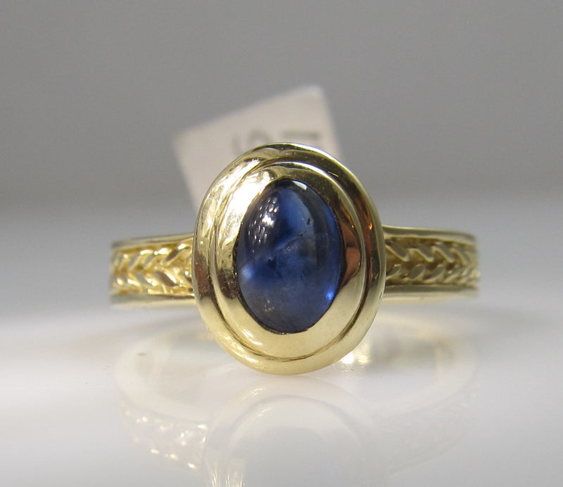 14k yellow gold ring with a cabochon cut sapphire