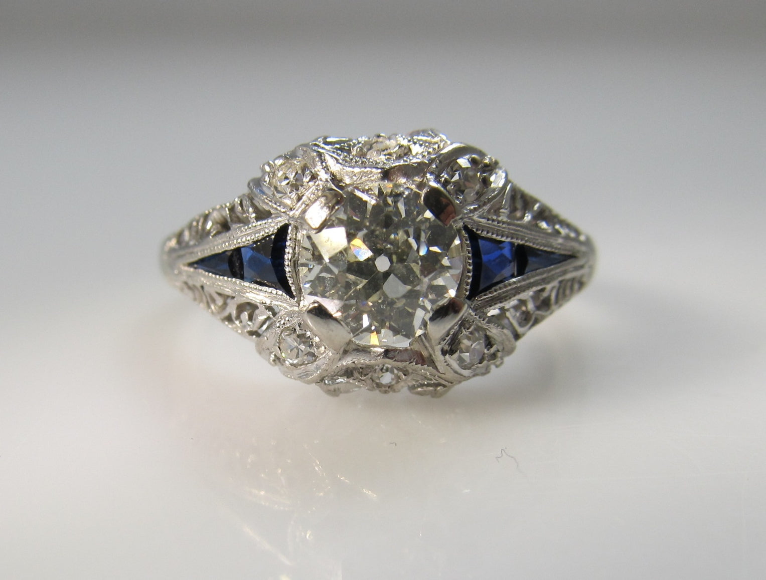 Antique platinum filigree ring with sapphires and a .75ct diamond, circa 1920.