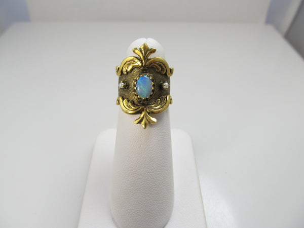 Wide yellow gold cigar band with opal and pearls