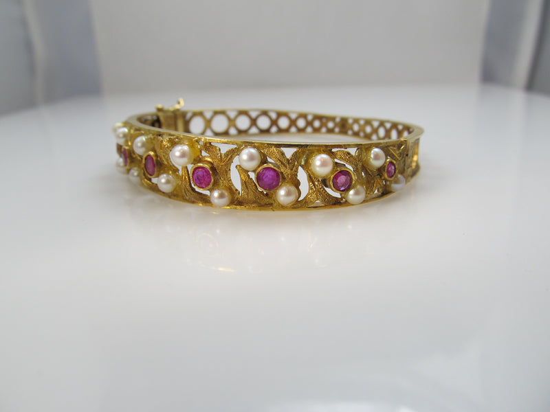 Vintage 18k yellow gold bangle bracelet with ruby and pearl