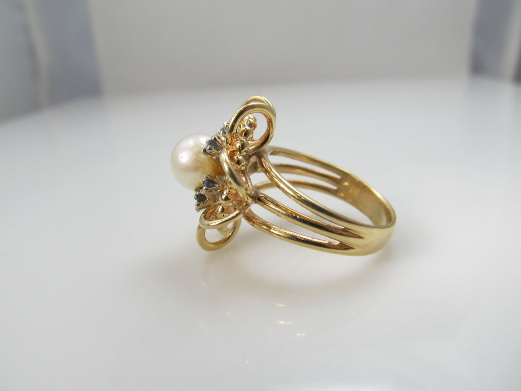 14k yellow gold ring with sapphires and a pearl