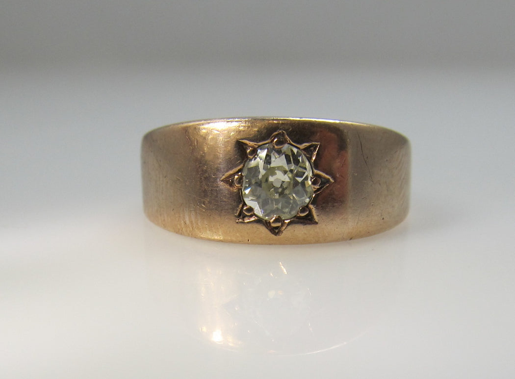 Antique 14k rose gold band with a .40ct cushion cut diamond