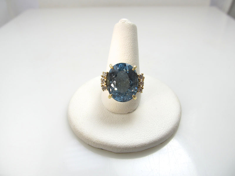14k yellow gold ring with diamonds and a 8.50ct blue topaz