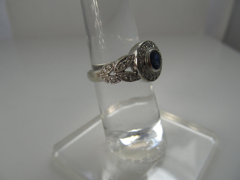 Sapphire and diamond halo ring, 14k white gold