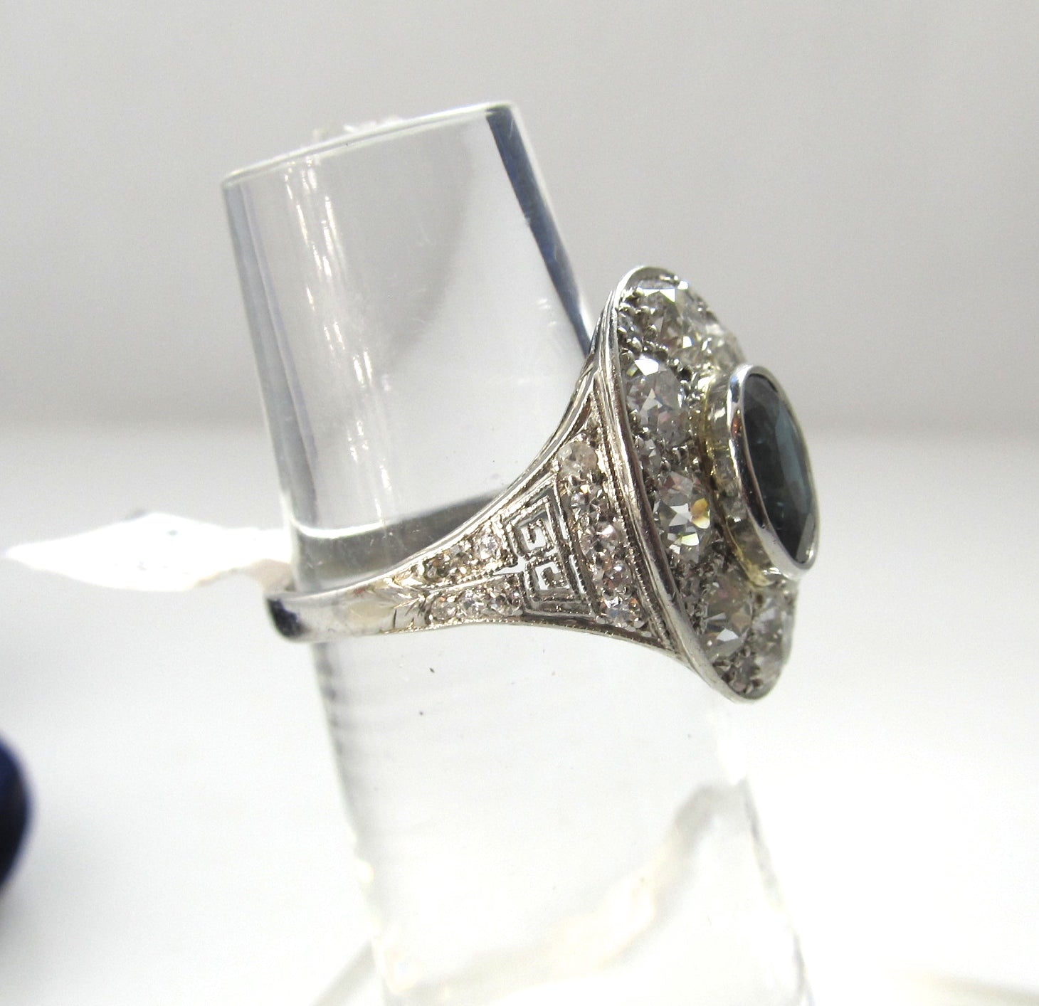 Antique platinum filigree statement ring with diamonds and a sapphire, circa 1920