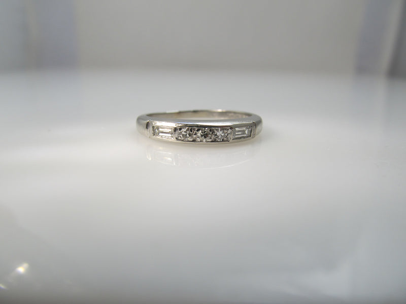 Antique platinum band with round and baguette cut diamonds
