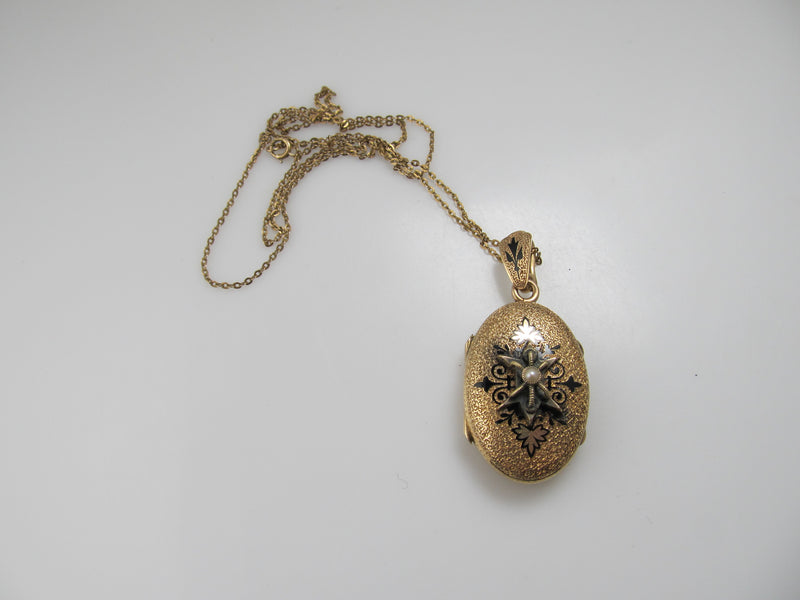 Victorian gold locket with enamel and a pearl